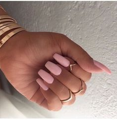 Baby pink coffin nails.