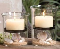 """Capturing the summer seashore perfectly, this set of two clear 6.3"""""""" t x 4.3"""""""" diameter glass Gibson hurricanes will add a glow to any celebration at the coast! Complete with iron shelves for holding"""
