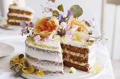 A Layered Carrot Cake with Cream Cheese Frosting that makes for a beautiful and decadent centerpiece for any kind of spring festivity!