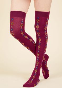 Give your look some fresh-cut flair but slipping into these magenta thigh highs! Patterned with goldenrod and cobalt blooms connected by leafy taupe stems in folksy columns, these knit socks tout retro vibes from knee to toe.