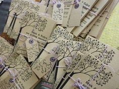 Gorgeous tree on tan paper, with purple twine, and tagged... These are decidedly some of the prettiest invitations I've seen. <3
