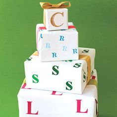 Take white wrapping paper then stamp the first initial of whoever its for.