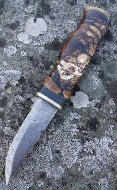Fabulous 25000-year shaft made of mammoth ivory by a Swedish knife maker.