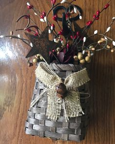 Property of Personalized Traditions - Primitive basket with rusty stars and pip berries