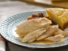 Slow-Cooker Pulled Turkey : Think the only thing you can pull is pork? Think again. Trisha is letting her slow cooker do the work of making a turkey breast juicy, moist and pull-apart tender. She cooks the meat with a mixture of fresh garlic and seasonings for over-the-top flavor.
