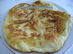Pan Cooked Borek (Tava Boregi) A traditional turkish bread-like recipe made of phyllo dough and stuffed with feta cheese