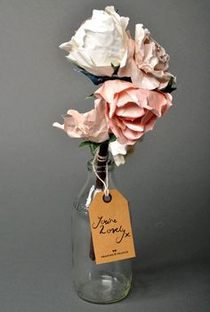 Beautiful flowers made from paper and twigs - @Frances & Francis  @Design Sponge