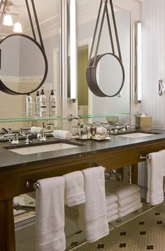 Hang a smaller mirror over a dull, unframed bathroom mirror. As seen on Decor to Adore. Click through to see other examples.