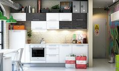 The mix of black and white cabinets in this minimalist kitchen add visual interest as well as storage space.