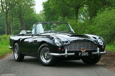 one day I'll have a vintage beauty like this rare Aston Martin DB5 convertible & my license plate will say KissMyAston :-)