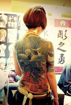 Dolphin Full Back Tattoo for Women - The sea life themed tattoo painted on the full back of the woman in a strong Japanese tattoo style, with dolphins and sea bottom landscape. Japanese Warrior Tattoo, Japanese Geisha Tattoo, Japanese Tiger Tattoo, Japanese Tattoos For Men, Traditional Japanese Tattoos, Japanese Tattoo Designs, Japanese Sleeve Tattoos, Full Back Tattoos, Back Tattoo Women