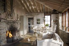 My dream stone cottage house: Called Hunting Island Cottage, located in Hunting Island, Maine. If I had a stone cottage this is close to what I'd want: Rough stone walls, antique furniture in whites and creams with pops of color, and a crisp but soft decor. Beautiful!