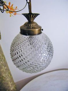 Hanging lamp in medium size, clear glass, dotted hobnob & swirl patterned  - Vintage. $46.00, via Etsy.