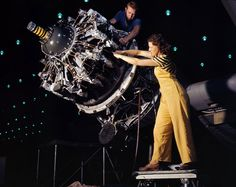 """October 1942. Long Beach, California. """"Women are trained to do precise and vital engine installation detail in Douglas Aircraft Co. plants."""""""