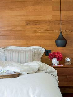 Tom Dixon's Beat Light Pendant at bedside: http://www.lumens.com/tom-dixon-beat-light/Search