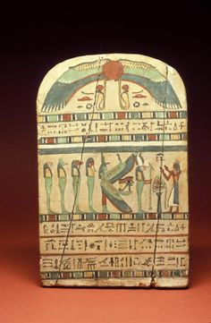 "Wood, painted. Of the God's - father of Amun, Irtierdji…. son of Nes-nebenteru and Djedhathormin. Scene of deceased adoring Osiris(?), Isis and four ""Children of Horus"". Thebes (Egypt) Locus: Ramesseum Period: Third Intermediate Period Twenty-Second Dynasty Date Made: 945 - 712 B.C.E. Penn Museum"