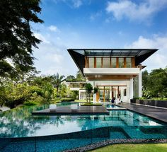 Villa, Outstanding Backyard Design Of Dalvey Road House With Dark Brown Floor Which Is Made From Wood And Big Blue Swimming Pool ~ Modern Residence Design with Awesome swimming Pool