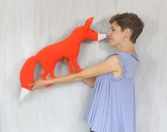 Soft and nice red fox — for animal lovers!  It can be a playmate, a fellow traveller, a cuddly toy which helps the child fall asleep in his own bed as well as while travelling or in a completely new place.  Sewn of soft orange and white fleece, it is filled with antiallergic sillicone filling, its eyes and nose made of buttons. This fox is waiting for a new owner!  Max. size (with tail)): ca 34 × 16 × 3″ (87 × 41 × 7.5 cm)    Made in a smoke free house.  Ready to ship.   Please check…