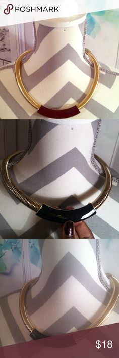 Chic Gold banded and black Necklace!! This Necklace is in very good condition!! This chic necklace has rarely been worn so no signs of wears or spots !! Jewelry Necklaces