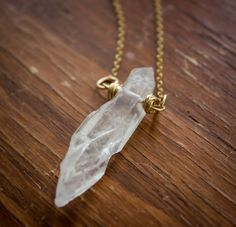 Hey, I found this really awesome Etsy listing at https://www.etsy.com/listing/195316427/clear-quartz-shard-pendant-with-14kt