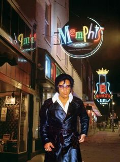 PHOTOSHOP!  A picture of Elvis that was taken in Los Angeles, CA on May 11, 1974 has been photoshopped onto a recent photo of Beale Street in Memphis/ TN. See the original pic at: http://www.elvis-collectors.com/candid-central/hotel74.html