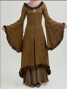 Eowyn's refugee coat. Hope to have a similar coat made for myself by next fall :) The sleeves are terribly impractical, but also fabulous.