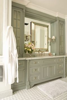 Lucas Studio - pale gray vanity cabinetry. Love this traditional/old fashioned version for a large powder room or guest bath.