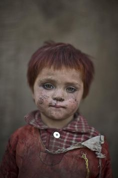 Associated Press photographer Muhammed Muheisen has captured candid photos of Afghan refugee children playing in a slum on the outskirts of Islamabad, Pakistan. Gul Bibi Shamra, age 3. #Afghan