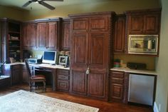 This is more of an office kitchen. It only has a minifridge and microwave. The large cabinets could house a murphy bed.