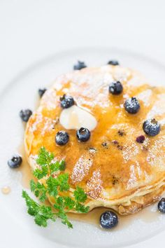 Yogurt in the batter and extra blueberries make these blueberry pancakes both flavorful and fluffy.