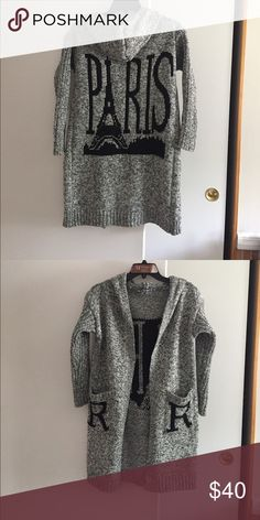 Brand new only took out of bag Only took out of bag to make sure not damaged  excellent quality sweater  fits sm/ med can be  worn 3/4 sleeves or long has 2 pockets in front and a hood Sweaters Cardigans
