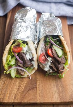 Deliciously flavorful and tender Beef Gyros, made in the slow cooker or instant pot pressure cooker. This tasty dish couldn't be easier to make from home!