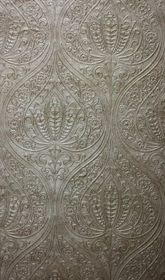 Campaldino    This is a heavily embossed wallpaper with a grand damask motif in metallic colourings
