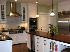 Mossy green color against the white cabinets and marble backsplash. Gorgeous! http://www.hgtv.com/kitchens/kitchen-backsplash-beauties/pictures/page-9.html?soc=pinterest