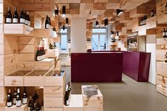 Reichmuth's wine shop that has reinvented itself into a 'green' wine shop by recycling the wine boxes to form the most innovative interiors ever! Designed by Swiss design house OOS, the shop has been given a very geometric and modern look by converting the wine boxes (made out of pine wood) into more than hundred marvelous display units for their wines.