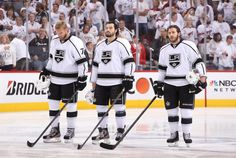 GLENDALE, AZ - MAY 15: (L-R) Jeff Carter #77, Drew Doughty #8 and Mike Richards #10 of the Los Angeles Kings stand at the blueline during the singing of the National Anthem prior to Game Two of the Western Conference Final against the Phoenix Coyotes during the 2012 NHL Stanley Cup Playoffs at Jobing.com Arena on May 15, 2012 in Phoenix, Arizona. (Photo by Christian Petersen/Getty Images)