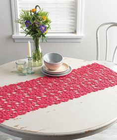 The old fashioned lace table runner gets a modern update in this design thanks to an eye-popping shade of hot pink cotton worked in an exploded gauge. The squares are joined to each other as you go, which makes finishing a breeze. Crochet Table Topper, Crochet Table Runner Pattern, Crochet Placemats, Crochet Doilies, Crochet Afghans, Lace Table Runners, Crochet Home Decor, Crochet Kitchen, Thread Crochet