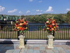 Outdoor pedestal arrangements with lilies, garden roses and mums | Pod Shop Flowers Wedding Designs | #outdoor #flowers #wedding