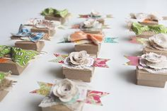 Conversation starter/favor boxes/place cards.   The gentlemen receive the bowties & burlap and for the ladies-canvas blossoms & lace.