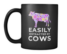 "Cute Cow Coffee Mug - This Adorable Cow Lovers Floral Coffee Cup Will Definitely Get Smiles - Grab Your ""Easily Distracted By Cows"" Gift Mug by Cartba on Etsy https://www.etsy.com/listing/579134037/cute-cow-coffee-mug-this-adorable-cow"