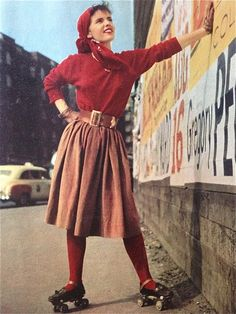 Vintage roller skater ... she looks happy to have the wall for balance!