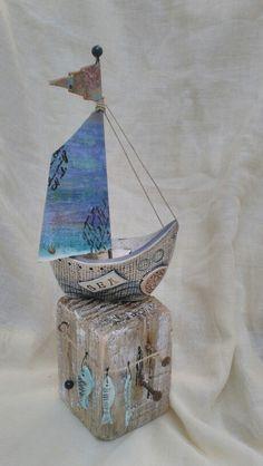 Ceramic boat on driftwood