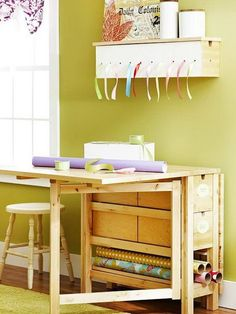Compact furniture ideas -- This wrapping and cutting station remains almost flat to the wall when not in use