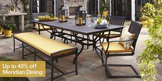 Yellow cushions make this heavy wrought-iron patio set seem so much friendlier