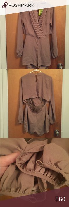 Taupe Open Back Romper NWT Brand new, never worn. The buttons on the arm are missing (3rd picture) but it's unnoticeable when wearing and the sleeve can be rolled up or new ones can easily be sewed on. Dresses