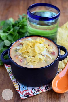 Gluten-free White Queso Chicken and Rice Soup tastes like white queso dip. Creamy, cheesy and delicious! | iowagirleats.com