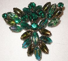 Here's a Carnival Glass leaf brooch that I once owned, but also sold.  It had a gun metal finish and was the first one of those that I'd ever seen.  I initially thought that this was original D jewelry, but have since learned that it is not.  I guess it will continue as an unsigned beauty for now.