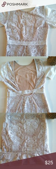For L & L San Marcos Mini Dress Look Alike Labeled M but runs small. Fits like an XS. Not From Love & Lemons. Purchased from a boutique. Normal wear. Worn a couple of times. Still in very good condition. No trades, no pp. boutique Dresses Mini