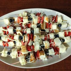 4th of July Dessert Kebobs! Blueberries, strawberries, and angel food cake, with white chocolate drizzle! Happy Birthday America!