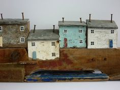 """There's a special charm about Kirsty Elson's driftwood houses. With their tiny windows, weathered driftwood doors and roofs of wood or slate held on with rusty nails, they evoke the naive art of St Ives 19th century fisherman-painter Alfred Wallis."""